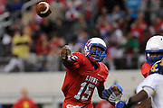 QB Del Barners who played with a heavy cast on his left wrist makes a pass during their UIL 3A Division I State Championship defeating the Chapel Hill Bulldogs 28-21 .