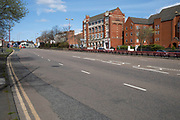 Local atmosphere due to Coronavirus lockdown is felt on a street by street level as streets remain deserted in Hockley as people observe the stay at home advice from the government on 7th April 2020 in Birmingham, England, United Kingdom. This area of main roads through central Birmingham is normally full of cars, but is currently eerily empty of vehicles. Coronavirus or Covid-19 is a new respiratory illness that has not previously been seen in humans. While much or Europe has been placed into lockdown, the UK government has announced more stringent rules as part of their long term strategy, and in particular social distancing.