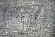 Prehistoric Petroglyph, rock carving, of what is known as the Map of Bebolina with depictions of huts raised on wooden poles  carved by the Camunni people in the iron age between 1000-1600 BC, Bedolina Rock no 1 , Seradina-Bedolina Archaeological Park, Valle Comenica, Lombardy, Italy .<br /> <br /> Visit our PREHISTORY PHOTO COLLECTIONS for more   photos  to download or buy as prints https://funkystock.photoshelter.com/gallery-collection/Prehistoric-Neolithic-Sites-Art-Artefacts-Pictures-Photos/C0000tfxw63zrUT4<br /> If you prefer to buy from our ALAMY PHOTO LIBRARY  Collection visit : https://www.alamy.com/portfolio/paul-williams-funkystock/valcamonica-rock-art.html
