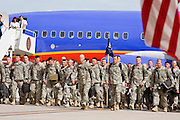 "30 MARCH 2008 -- PHOENIX, AZ: About 250 members of the Arizona Army National Guard's 158th Infantry Battalion march into an Air Force hangar during their arrival ceremony Phoenix, AZ, Sunday after a year long deployment in Afghanistan Sunday. The unit, also known as the ""Bushmasters"" from their service in World War II, was part of the largest single-unit deployment of the Arizona National Guard since the second World War. Two members of the battalion were killed in action during their deployment. The battalion, a combat unit, engaged in counter insurgency operations through out their deployment. Photo by Jack Kurtz / ZUMA Press"