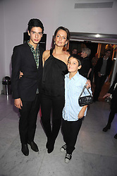 SAFFRON ALDRIDGE and her sons MILO ASTAIRE (L) and FINN CONSTANTINE (R) at an exhibition of work by Alan Aldridge held at the Design Museum, Shad Thames, London on 13th October 2008.