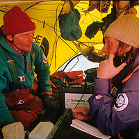 Having reached the South Pole, about halfway through the 1989-1990 Trans-Antarctica Expedition, Jean-Louis Etienne and Victor Boyarsky attempt to radio news to the outside world.
