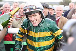 ©Licensed to London News Pictures. 07/11/2013<br /> Towcester Racecourse, Northamptonshire. AP McCoy wins the magic 4000 at Towcester Racecourse beating Jamie Moore on Kris Spin in the 3:10 Weatherbys Novice hurdle race.<br /> Photo credit: Steven Prouse/ LNP