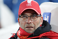 Jürgen Klopp, the Liverpool manager looks on from the dugout before k/o. The Emirates FA cup, 4th round replay match, West Ham Utd v Liverpool at the Boleyn Ground, Upton Park  in London on Tuesday 9th February 2016.<br /> pic by John Patrick Fletcher, Andrew Orchard sports photography.