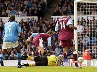Manchester City v West Ham United, FA Barclaycard Premiership, Maine Road, Manchester. 27/04/2003.<br />West Ham's Don Hutchison looks to scramble the ball home beyond the reach of Man City goalkeeper Peter Schmeichel.<br />Photo: Jed Wee, Digitalsport