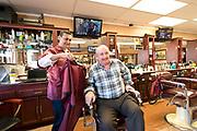 Roman Nektalov is a Russian immigrant owner of Central Barbershop in Downtown Phoenix, AZ. on March 1, 2017.