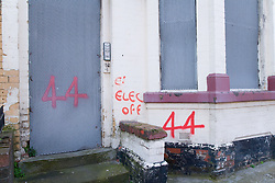Metal shutters on derelict house with sign indicating that the electricity has been disconnected in preparation for demolition as part of the pathfinder regeneration scheme Bootle; Liverpool; England,