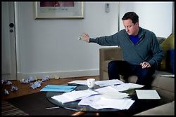 Leader of the Conservative Party David Cameron prepares for the first ever Live TV debate between the 3 political leaders in his hotel room in Manchester, during the 2010 general election campaign, Thursday April 15, 2010. Photo By Andrew Parsons / i-Images.