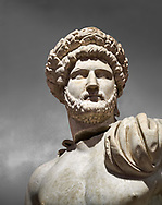 Roman statue of Emperor Hadrian .Marble. Perge. 2nd century AD. Inv no 3861-3863 .Antalya Archaeology Museum; Turkey. Against a grey background .<br /> <br /> If you prefer to buy from our ALAMY STOCK LIBRARY page at https://www.alamy.com/portfolio/paul-williams-funkystock/greco-roman-sculptures.html . Type -    Antalya     - into LOWER SEARCH WITHIN GALLERY box - Refine search by adding a subject, place, background colour, museum etc.<br /> <br /> Visit our ROMAN WORLD PHOTO COLLECTIONS for more photos to download or buy as wall art prints https://funkystock.photoshelter.com/gallery-collection/The-Romans-Art-Artefacts-Antiquities-Historic-Sites-Pictures-Images/C0000r2uLJJo9_s0