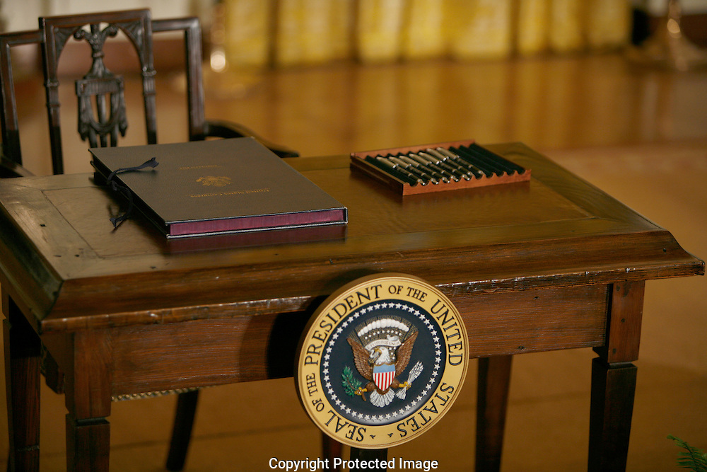 Presidential pens are ready for the signing of the Iran Sanctions Act in the East Room of the White House on July 1, 2010.  Photograph by Dennis Brack