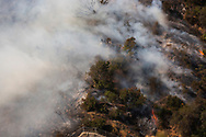 Getty Fire Burns in Los Angeles,<br /> A small brush fire burns in the hills near the Getty Center in Los Angeles. Fire fighting aircraft quickly contained the Santa Ana wind driven fire.<br /> 10/28/2019 Los Angeles, CA USA<br /> (Photo by Ted Soqui)
