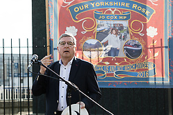 © Licensed to London News Pictures. 16/06/2017. LONDON, UK.  Jim Fitzpatrick, MP for Poplar and Limehouse speaks at The Great Get Together. Neighbours and friends of Jo Cox attend The Great Get Together near Hermitage Moorings in Wapping to pay tribute and celebrate Jo's call that more unites us than divides us on the anniversary of her death. Jo Cox lived on a house boat in Wapping with her husband Brendan Cox and two children. Photo credit: Vickie Flores/LNP