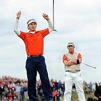 The Netherlands, Zandvoort, 15-09-2013.<br /> Golf, KLM Open.<br /> Joost Luiten from the netherlands wins the play off on the 18th hole of the KLM Open and throws his club in the air when he celebrates his victory while the deafeted Miguel Angel Jimenez from Spain is looking very disappointed.<br /> Photo : Klaas Jan van der Weij