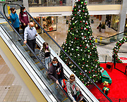 Shoppers ride down the center court escalator at St. Clair Square mall on Fairview Heights on Friday November 27, 2020. <br /> Photo by Tim Vizer