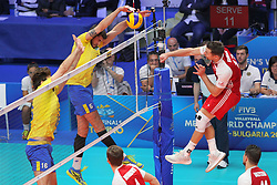 September 30, 2018 - Turin, Piedmont, Italy - Michal Kubiak of Poland against Lucas Eduardo Loh of Brazil during the final match between Brazil and Poland for the FIVB Men's World Championship 2018 at Pala Alpitour in Turin, Italy, on 30 September 2018. Poland won 3: 0 and it is confirmed world champion. (Credit Image: © Massimiliano Ferraro/NurPhoto/ZUMA Press)