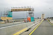 Nederland, Nijmegen, 4- 3-2019 Na een vertraging van bijna een jaar is aannemer KWS in opdracht van Rijkswaterstaat begonnen met het groot onderhoud aan de oude, iconische Waalbrug . De brug wordt de komene maanden grondig gerenoveerd en opgeknapt. Het onderhoud is hard nodig want op veel plaatsen zijn dikke plakken roest onder meer van opspattend strooizout gevormd . Het bleek dat de oude verf chroom6 bevat waardoor de renovatie is uitgesteld vanwege extra veiligheidsmaatregelen. De brug is gebouwd in 1936 en was toen de langste boorbrug van Europa . Eerst wordt de onderkant onder handen genomen, en later wordt de brug opnieuw geschilderd als ook duidelijk is hoe de oude verf het beste verwijdert kan worden . Foto: Flip Franssen