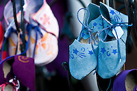 Handmade shoes in a fair hanging to be sell. Copyspace for your copy at the left.