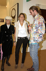 Left to right, Rock Roll figure ANITA PALLENBURG, STELLA SCHNABEL daughter of artist Julian Schnabel and DAN COLEN at a private view of the 2004 Frieze Art Fair - a major exhibition attended by most of the leading contempoary art dealers held in Regents Park, London on 14th October 2004.NON EXCLUSIVE - WORLD RIGHTS