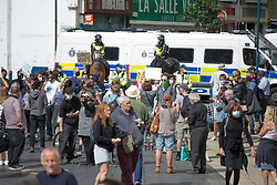 ©️ Licensed to London News Pictures. 05/09/2020. Dover, UK. Police separates anti-racism  activists and anti-immigration group that gather in town. There are fears of violence in as rival far-right and pro-migrant groups are expected to assemble to demonstrate over migrant crossings.  Photo credit: Marcin Nowak/LNP