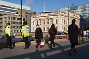 Three days after the killing of Jack Merritt, 25, and Saskia Jones, 23, by the convicted teorrorist Usman Khan at Fishmongers Hall on London Bridge, police officers make a high-profile presence to ensure the public feel safe, in the City of London, on 2nd December 2019, in London, England.
