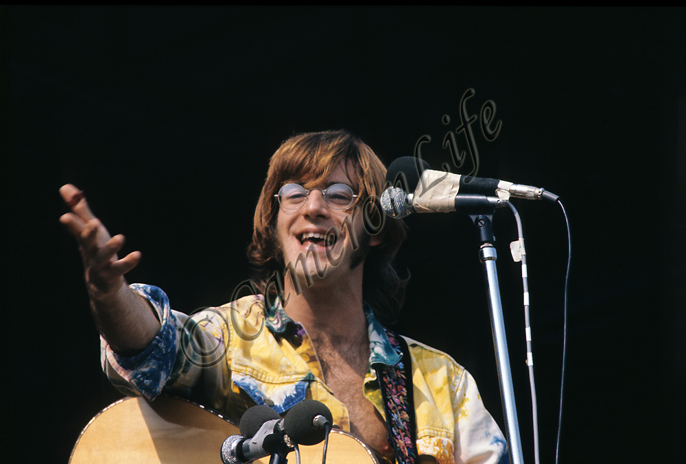 """John Sebastian.- .A man of many faces, clean shaven in The Lovin Spoonful, but now more relaxed as he was reunited with old colleague John Sebastian. Brian Hinton in his book """"Message to Love"""" remembers him as being ubiquitous and a symbol of permanence - almost as if his presence was dependent on the success of the festival, he seemed to be everywhere!"""
