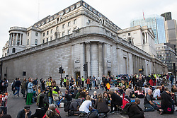 London, UK. 2nd September, 2021. Extinction Rebellion climate activists divide into groups for planning decision-making outside the Bank of England on the eleventh day of Impossible Rebellion protests. Over 50 activists wore signs indicating that they were breaking restrictive bail conditions by entering the City of London. Extinction Rebellion are calling on the UK government to cease all new fossil fuel investment with immediate effect.