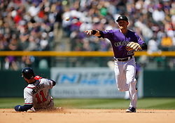 April 8, 2018 - Denver, CO, U.S. - DENVER, CO - APRIL 08: Colorado Rockies infielder Trevor Story (27) turns a double play as Atlanta Braves Outfielder Ender Inciarte (11) slides into second base during a regular season MLB game between the Colorado Rockies and the visiting Atlanta Braves on April 8, 2018 at Coors Field in Denver, CO. (Photo by Russell Lansford/Icon Sportswire) (Credit Image: © Russell Lansford/Icon SMI via ZUMA Press)