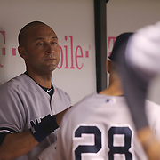New York Yankees shortstop Derek Jeter (2) is seen in the dugout during a major league baseball game between the New York Yankees and the Tampa Bay Rays at Tropicana Field on Thursday, Sept. 17, 2014 in St. Petersburg, Florida. The Yankees won the game 3-2 and this was Jeter's last game against Tampa Bay. (AP Photo/Alex Menendez)