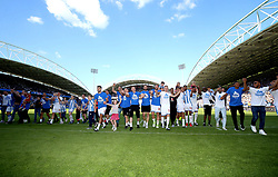 Huddersfield Town players celebrate at the end of the match with young fans and mascots
