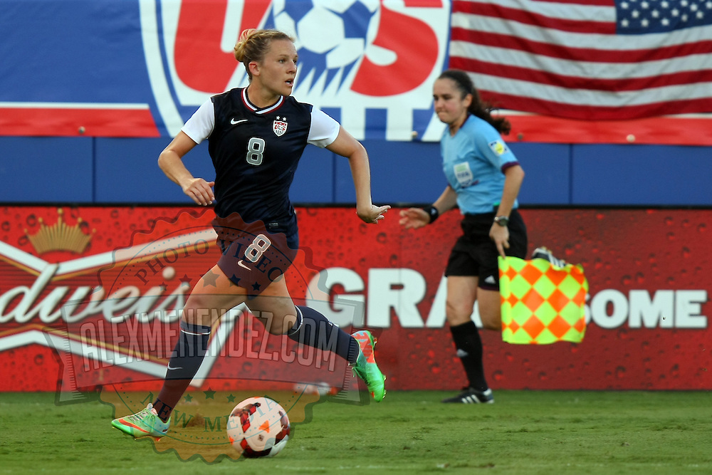 U.S. forward Amy Rodriguez dribbles the ball during an international friendly soccer match between the United States Women's National soccer team and the Russia National soccer team at FAU Stadium on Saturday, February 8, in Boca Raton, Florida. The U.S. won the match by a score of 7-0. (AP Photo/Alex Menendez)