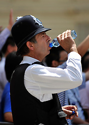 © licensed to London News Pictures. LONDON, UK.  27/06/11.A police officer drinks from a bottle of water in Whitehall. Londoners cool off and enjoy the hot weather in london today (27 June2011). Mandatory Credit Stephen Simpson/LNP