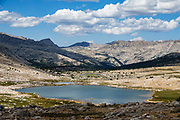 From Piute Pass, see Desolation Lake in Humphreys Basin, in John Muir Wilderness, Inyo National Forest, California, USA. Hiking to Piute Pass is 9.7 miles round trip with 2200 ft gain.