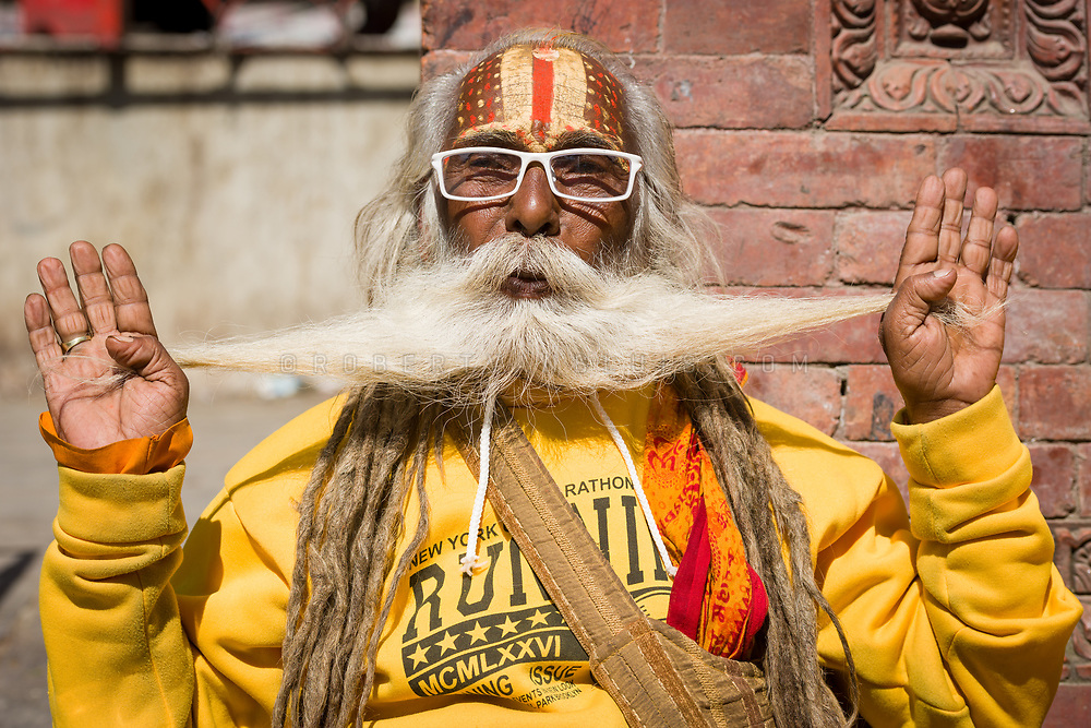 A sadhu shows the length of his beard at Durbar Square, Kathmandu, Nepal. Photo © robertvansluis.com