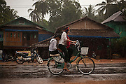 Children go home after school while it rains Tanintharyi Region, Burma.<br /> Note: These images are not distributed or sold in Portugal