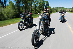 Chuckie Freeman (L), Buck Chavarria, and Kona Ward riding the 20 Mile Road in Steamboat Springs during the Rocky Mountain Regional HOG Rally, Colorado, USA. Saturday June 10, 2017. Photography ©2017 Michael Lichter.