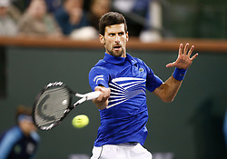 March 9, 2019 - Indian Wells, CA, U.S. - INDIAN WELLS, CA - MARCH 09: Novak Djokovic (SRB) hits a forehand during the second round of the BNP Paribas Open on March 09, 2019, at the Indian Wells Tennis Gardens in Indian Wells, CA. (Photo by Adam Davis/Icon Sportswire) (Credit Image: © Adam Davis/Icon SMI via ZUMA Press)