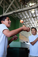 Alejandro Aguilar practices kendama with a pool ball. The wooden ball he's holding in his left hand is light, which makes it harder to catch in a cup.