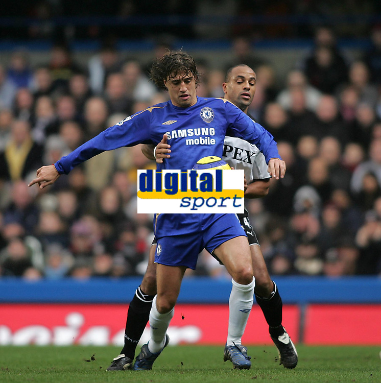 Photo: Lee Earle.<br /> Chelsea v Fulham. The Barclays Premiership. 26/12/2005. Chelsea's Hernan Crespo (F) holds off Alain Goma.