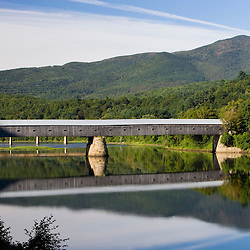 The Windsor-Cornish Covered Bridge spans the Connecticut River between Windsor, Vermont and Cornish, New Hampshire. Longest covered bridge in the world.  Mount Ascutney is in the distance.