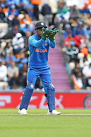 Cricket - 2019 ICC Cricket World Cup - Group Stage: South Africa vs. India<br /> <br /> MS Dhoni of India prepares to catch a throw from the boundary showing the illegal logo on his gloves during the cricket world cup match at the Hampshire Bowl Southampton England<br /> <br /> The regulations for ICC events do not permit any individual message or logo to be displayed on any items of clothing or equipment. In addition to this, the logo also breaches the regulations in relation to what is permitted on wicketkeeper gloves.<br /> <br /> COLORSPORT/SHAUN BOGGUST