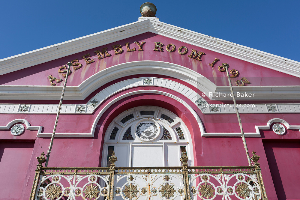 "Exterior of the Magic Lantern cinema - formerly known as the Assembly Rooms (1893), on 12th September 2018, in Tywyn, Gwynedd, Wales. The Magic Lantern Cinema has shown films right at the start of Cinema in the UK, 9 years earlier than any other operating Cinema in the Britain. It was re-christened as ""The Assembly Cinema"" after World War 1 and subsequently as 'The Ritzy', 'Tywyn Cinema' and now, as a nod to it's historic past, 'The Magic Lantern'."