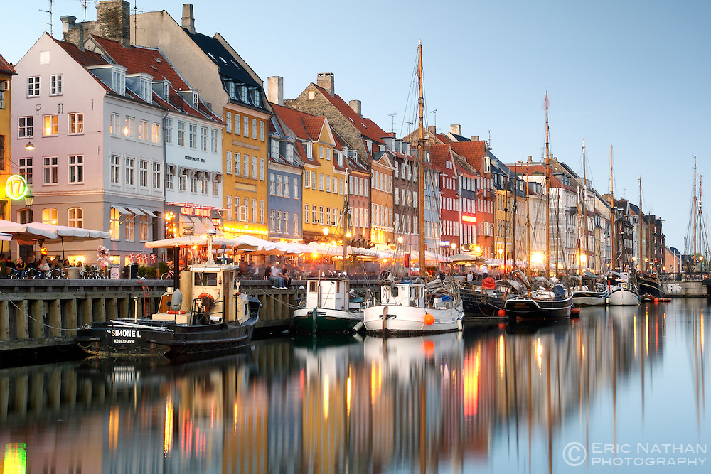 Boats and side-walk cafes along the Nyhavn canal in Copenhagen, Denmark.