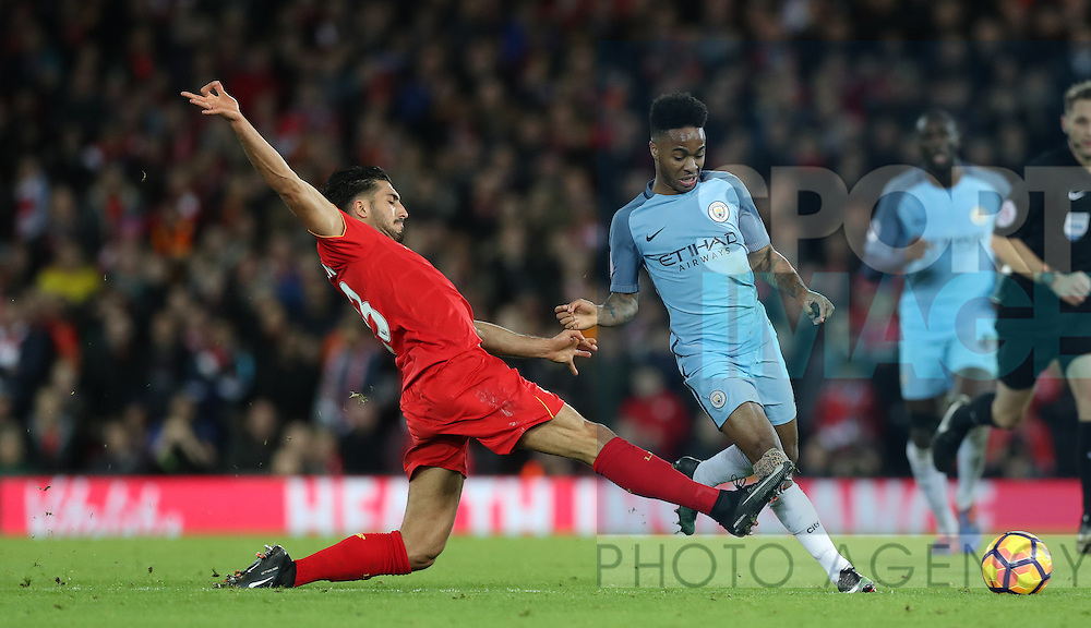 Raheem Sterling of Manchester City and Emre Can of Liverpool during the English Premier League match at Anfield Stadium, Liverpool. Picture date: December 31st, 2016. Photo credit should read: Lynne Cameron/Sportimage
