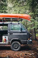 Syncro VW Van with canoe camping near Mt Rainier, WA.