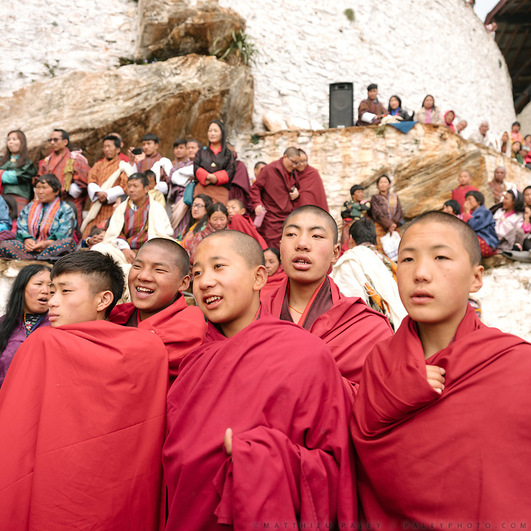 Young monk watching the performance. The Tshechu of the Gasa monastery on the road leading to Laya. Tshechu are annual religious Bhutanese festivals held in each district on the tenth day of a month of the lunar Tibetan calendar. Tshechus are large social gatherings, which perform the function of social bonding among people of remote and spread-out villages.