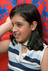 Young girl taking eyesight test,