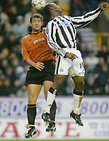 Fotball<br /> Premier League England<br /> 29.11.2003<br /> Wolverhampton v Newcastle<br /> Paul Butler - Wolves<br /> Titus Bramble - Newcastle<br /> Foto: Morten Olsen, Digitalsport