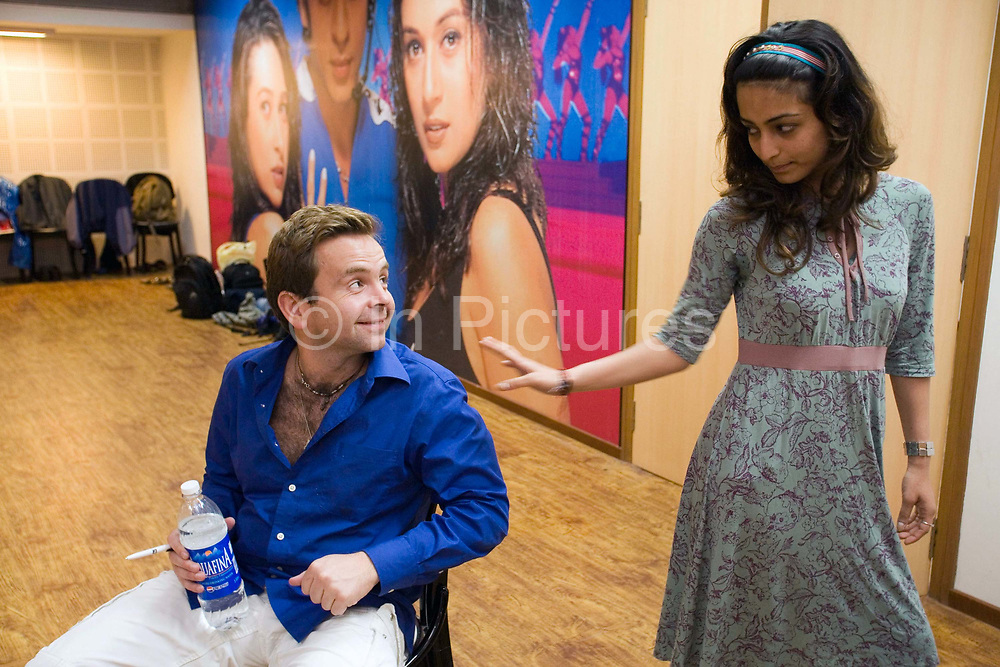 Writer and Director Toby Gough with assistant choreographer Shruti Merchant in rehearsals for the Merchants of Bollywood at the Yash Raj Studios in Mumbai (Bombay), India.<br /> <br /> The Merchants of Bollywood, An Indian theatrical dance musical, charts the history of the world's largest and most prolific film industry, and is loosely based on the showbusiness, Merchant family. Seen by over two million people worldwide, the show is homage to the world of Indian cinema.