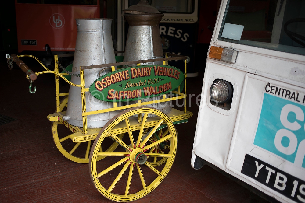 Hand pulled milk cart from the Osborne Dairy in Saffron Walden on open day at Wythall Transport Museum on May 1st 2017 in Wythall, England, United Kingdom. The Transport Museum, Wythall is a transport museum just outside Birmingham, at Wythall, Worcestershire.The museum is run by the charity The Birmingham and Midland Motor Omnibus Trust BaMMOT. The museum has three halls, presenting a significant collection of preserved buses and coaches, including Midland Red and Birmingham City Transport vehicles. It is also home to the Elmdon Model Engineering Society EMES who operate the Wythall miniature railway within the grounds of the transport museum, giving rides to public on miniature steam trains.