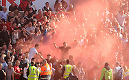 Liverpool fans set off a flare in the stand.  Premier league match, Stoke City v Liverpool at the Bet365 Stadium in Stoke on Trent, Staffs on Saturday 8th April 2017.<br /> pic by Bradley Collyer, Andrew Orchard sports photography.